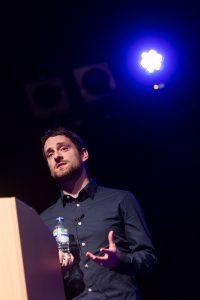 Joe Tuckwell presenting on stage at Digital Gaggle