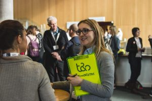 A member of the t&s team chatting to a delegate at Digital Gaggle