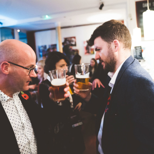 Speakers Alan Thorpe and James Whatley share a toast (or are they facing off?)