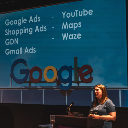 Arianne speaking on stage at Digital Gaggle